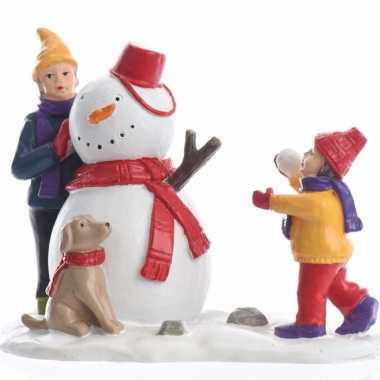 Kerstdorp maken figuurtjes sneeuwpop bouwen ,